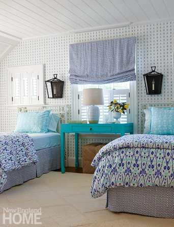 Two twin beds and a turquoise night stand.