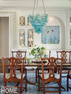 The dining room glows, thanks to the wallpaper's metallic hints.