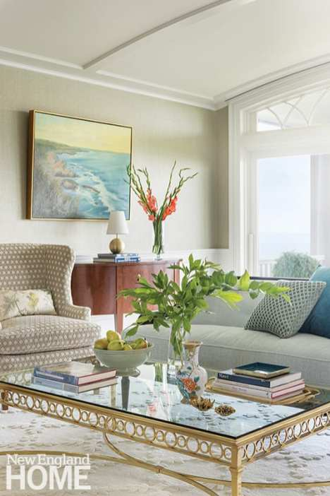 The home features numerous works by local artists, including the living room's dreamy paintings by Rhode Islander Vanessa Piche.