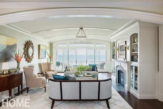 Furniture, like interior designer Patti Watson's custom curved sofa, speaks to tradition without being fussy.