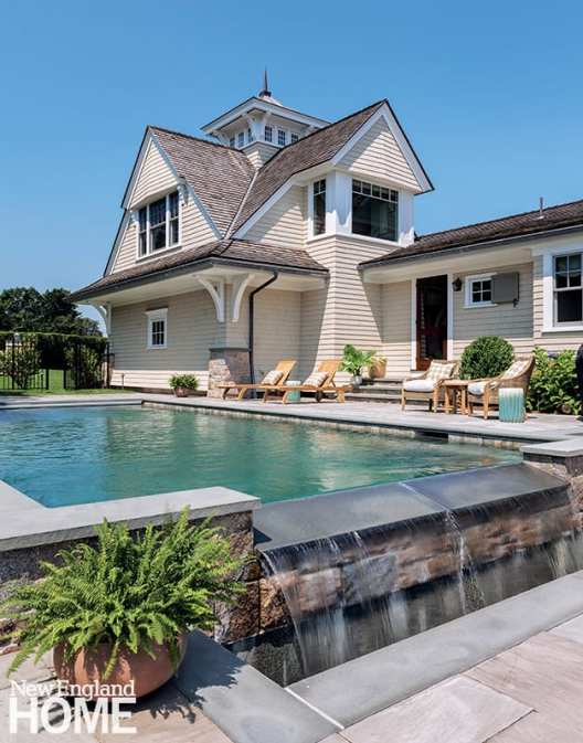 The swimming pool sits to the side of the house, rather than the back, says Muoio, because Kathy wanted to ensure nothing man-made would interrupt the sightline to the water.
