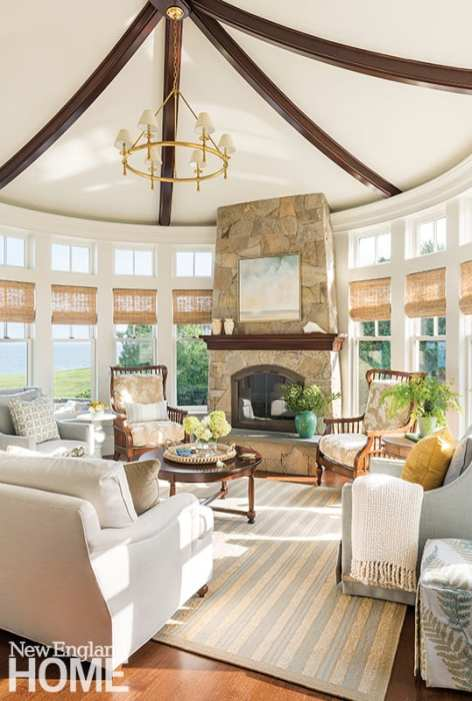 """Whether washed with sunlight or aglow by firelight, the sunroom is a favorite gathering spot where the focus is on togetherness. """"My younger daughter designated it a no-technology room,"""" says Kathy."""