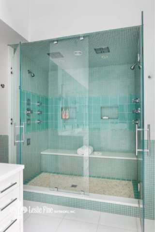 Leslei Fine shower with teal glass tile