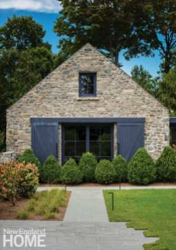Dressed in stone chiseled from the ground, the garage serves as a gateway to the property and forms a courtyard with the house.