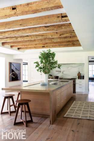 A dining bar on the kitchen island, held in place with hand-cut dovetails and a single ebony pin, is made from the same tree used for the kitchen tables and bench.