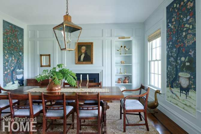 The dining room is a study in traditional style—without being too cloying or stuffy. The designer sourced the vintage dining table and chairs, chest, and lantern from Montage Antiques in Millerton, New York. The whimsical hand-painted wall panels are from UK-based Fromental.