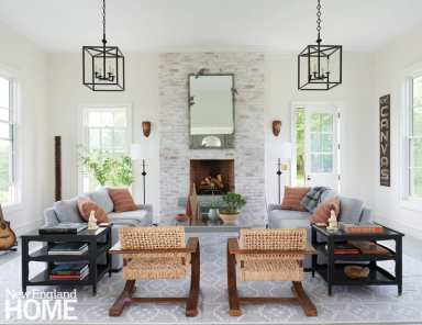 The modern—compared to the rest of the house—living room acts as the heart of the home for the family of five. A mix of materials and profiles kicks the style quotient up a notch, with a custom Bombay Sprout rug, rope chairs from Mecox Gardens, and floor lamps and a coffee table from RT Facts in Kent.