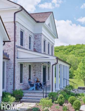 Traditional columns define the back porch.