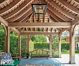 Interior designer Tim Button chose furnishings that are the same color and period as the pergola; the lantern is a custom Paul Ferrante fixture enlarged for scale.
