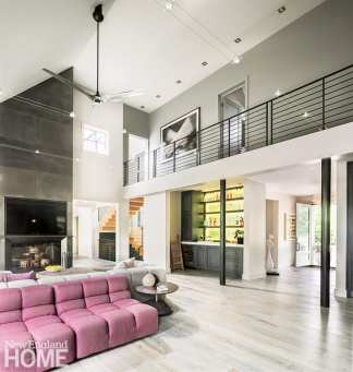 Great room with gray walls and pink sofa