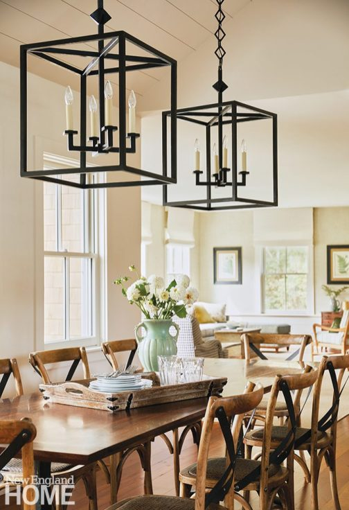 Dining table with two large lanterns.