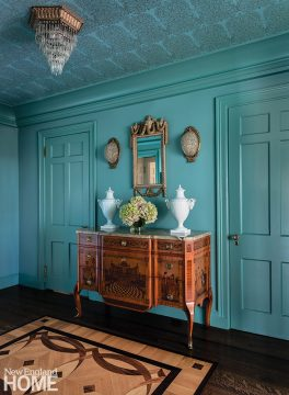 Aqua-blue with antique commode.