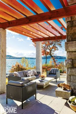 Outdoor seating area of contemporary lake front home.