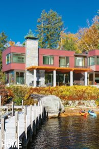 Dock and back of contemporary Lake Sunapee home.