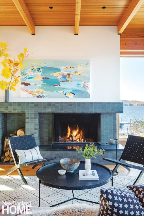 Living room with a tiled fireplace and contemporary art.
