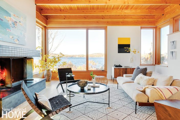 Contemporary lake front living room with views.