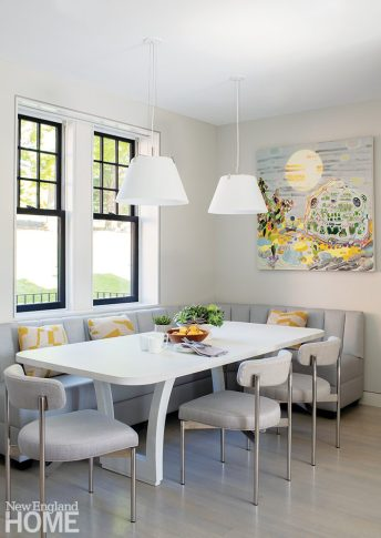 Kitchen banquette with a white table and chairs