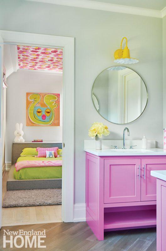 Children's bathroom with bright pink vanities.