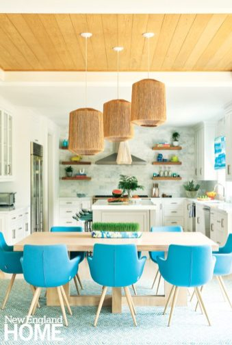 Colorful kitchen with natural fiber pendant lights.