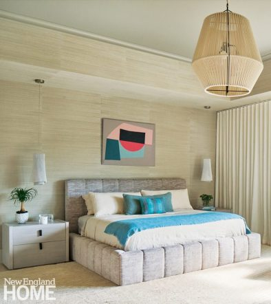 Primary bathroom with neutral walls and bright blue pillows.