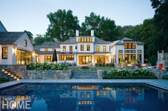 Rear exterior and pool of grand Fairfield, Connecticut home.