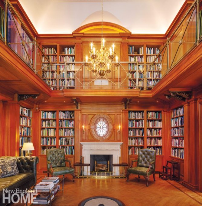Hand-waxed pine shelves and millwork were designed to create a library evocative of an English Country estate; the urn-shaped details on the custom bronze balcony railing and the sunburst window above the fireplace recall the period style of Bellevue House.