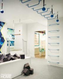 Childrens playroom with foam ball pit and trapeze bars