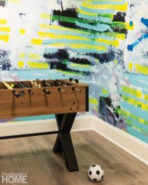 Foosball table with bright mural