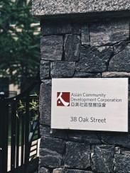 Sign identifies developer of building.