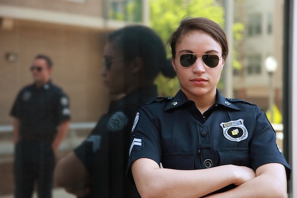 female security guard poses for photo