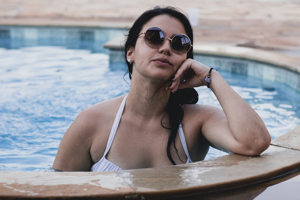 woman in pool with septum piercing
