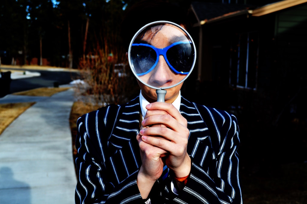 Person looking through spyglass