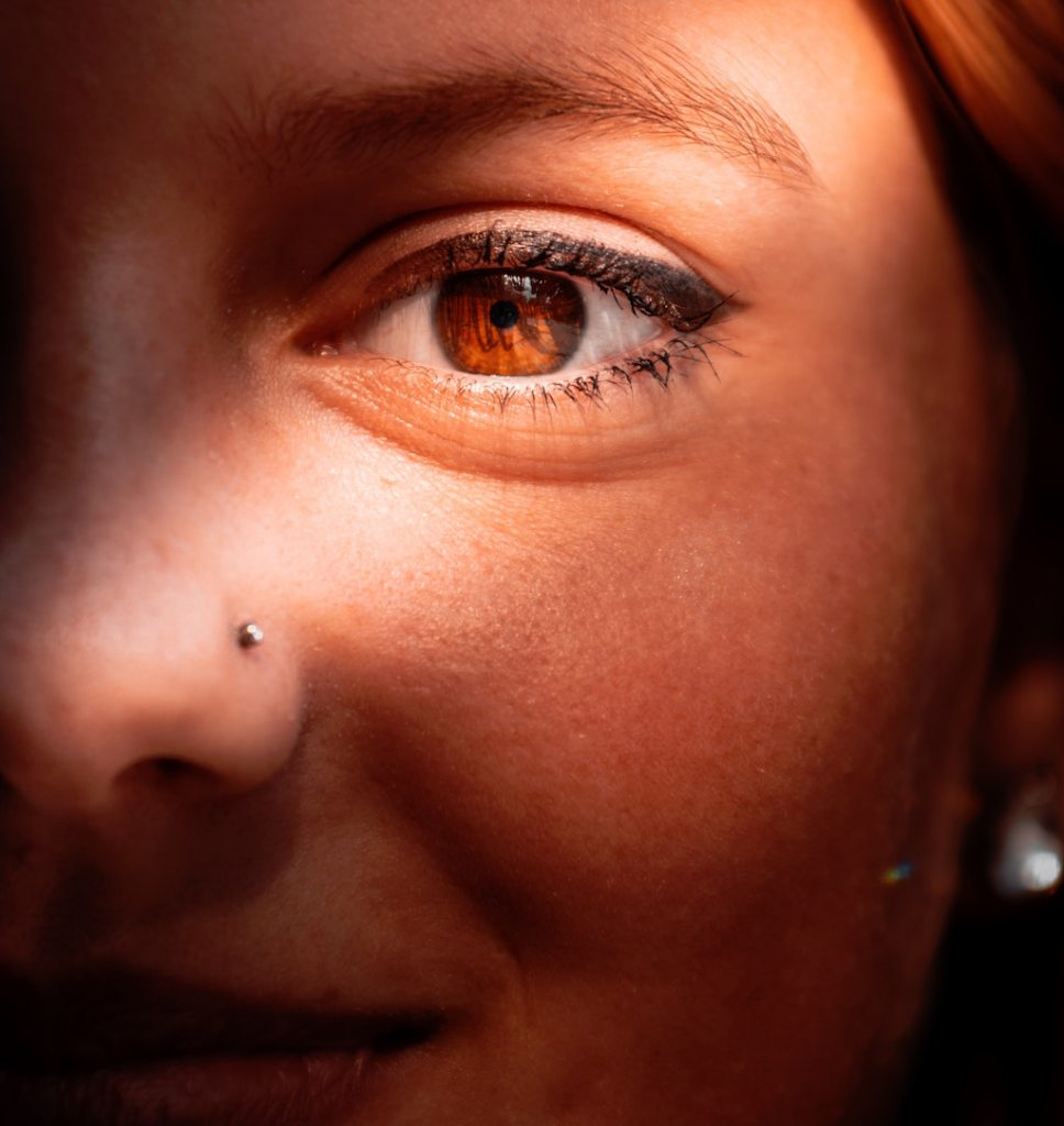 closeup of woman with nose piercing