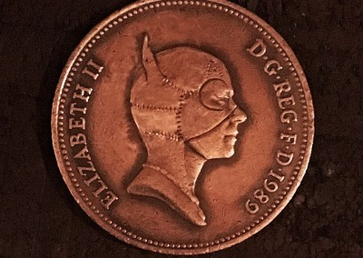 Cat woman coin