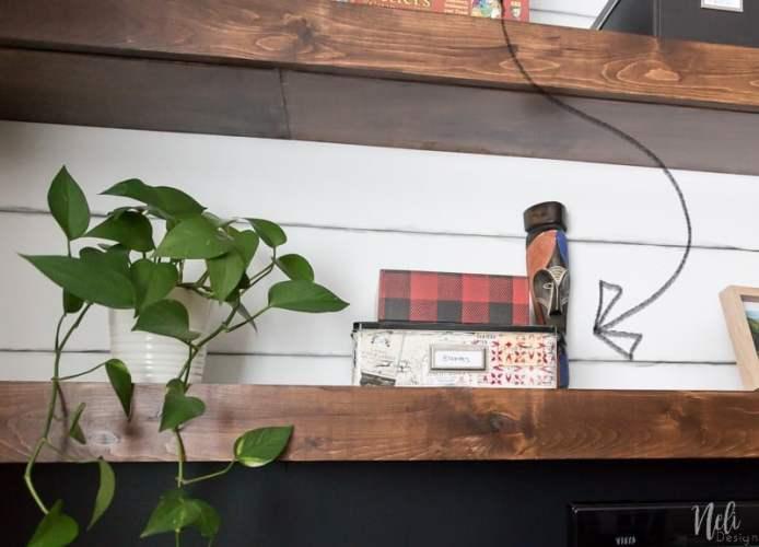 Family room makeover | $ 100 Room Challenge | false shiplap | pencil | DIY floating shelves | cinema | organization | TV | wall | paint color | fireplace | Vintage map | Distress map | vintage geographical map | color paint behind TV | TV Wall | home | decoration | floating shelves | home cinema
