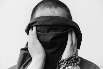 Tibetan monk who fled from Tibet last summer. Afraid to be seen
