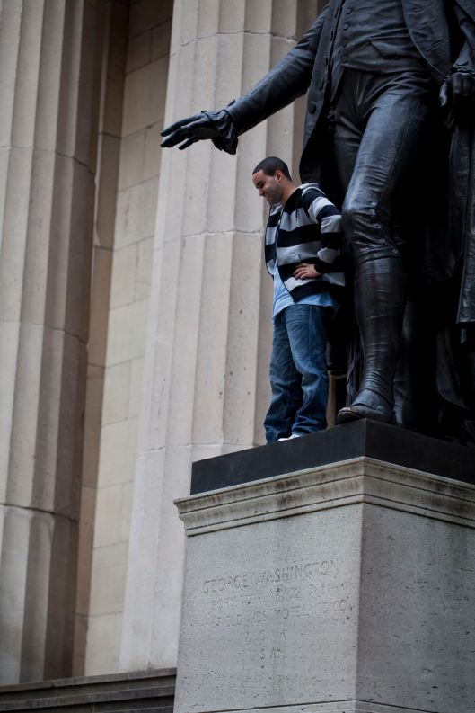 Man On Statue Plinth