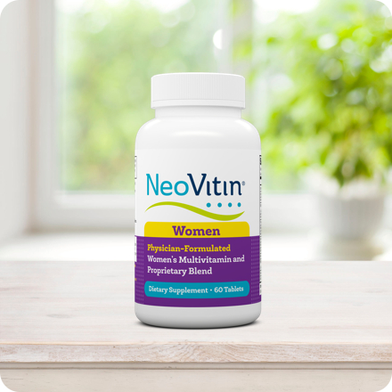 NeoVitin Womens Bottle on Table with Plant in Background