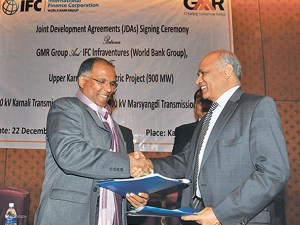 Officials exchange agreement documents during a signing ceremony in Kathmandu on Monday.