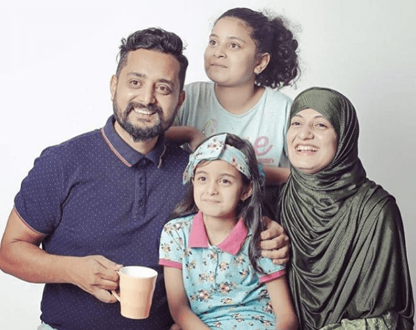 Asif Shah with his wife and two daughters