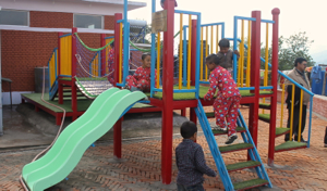 NRH kids on play structure