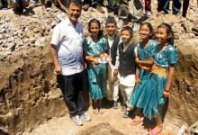 Children lay the cornerstone of the new J & K Village.