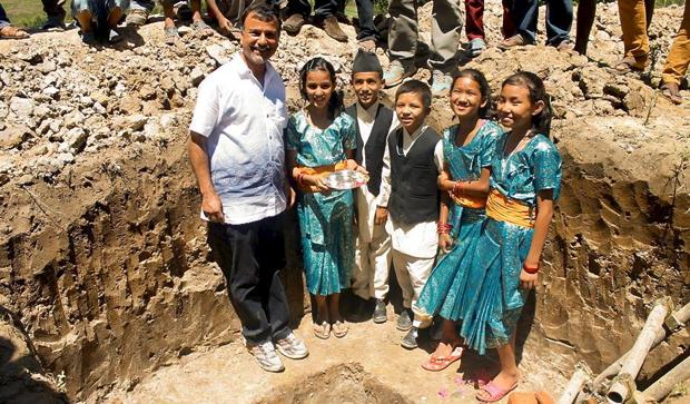 Children lay the cornerstone of the new J & K Village