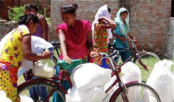Raj Kumari with flood relief supplies