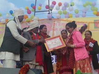 Bishnu Chaudhary receives an award for her activism at Maghe Sankranti 2020.