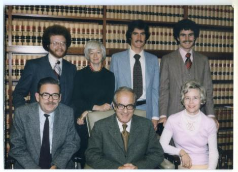 NYF Founder Olga Murray during her law career, posing with California Supreme Court Justice Mosk and his staff.