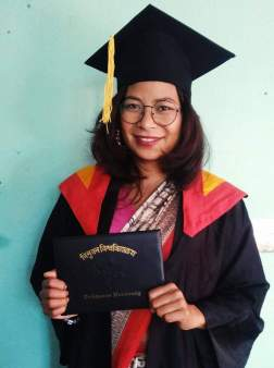 Bishnu Chaudhary graduates from law school. She is the first from the Freed Kamlari community to pass Nepal's bar exam.