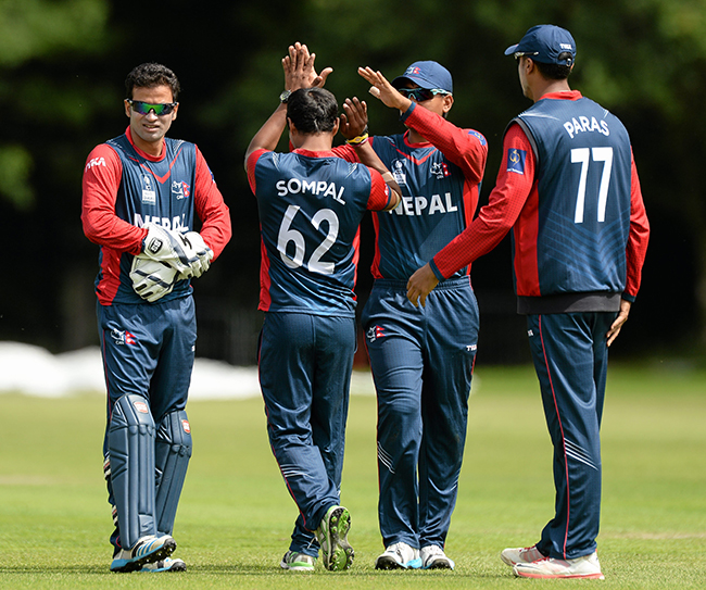 10 July 2015; Sompal Kami, Nepal, is congratulated by team-mates after taking the wicket of Shiva Vashishat, USA, with an LBW. ICC World Twenty20 Qualifier 2015, Nepal v USA. Stormont, Belfast. Picture credit: Oliver McVeigh / ICC / SPORTSFILE