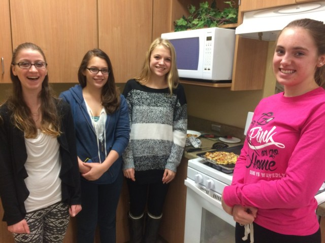Approximately 80 students participated in the cultural cooking lab using pork at Elkhorn South High School. These girls pose with their okonomiyaki as it finishes cooking on the griddle.