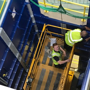 Engineers Work Inside The Lift Shaft